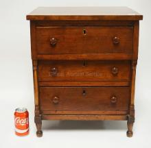 ANTIQUE DIMINUTIVE 3 DRAWER CHEST WITH TURNED COLUMNS AND FEET. 21 3/4 INCHES HIGH. 18 1/8 INCHES WIDE.