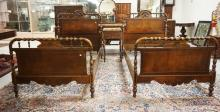 7 PIECE BERKEY & GAY BEDROOM SET FEATURING FIGURED WALNUT, TURNED LEGS, CARVED MIRROR CRESTS, AND MARBLE TOPS.