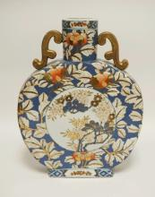 ASIAN PORCELAIN FLAT VASE DECORATED WITH FLOWERS. 16 1/2 INCHES HIGH.