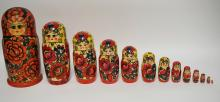 13 PIECE HAND PAINTED RUSSIAN NEST OF WOODEN DOLLS. TALLEST IS 13 INCHES HIGH AND THE SMALLEST IS 5/8 OF AN INCH HIGH.