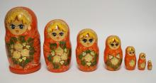 7 PIECE HAND PAINTED RUSSIAN NEST OF WOODEN DOLLS. TALLEST IS 7 3/4 INCHES HIGH. SMALLEST IS 1 1/8 INCHES HIGH.