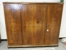 4 DOOR WARDROBE WITH BOOK MATCHED DOORS AND CARVED LEGS.89 INCHES WIDE. 76 INCHES HIGH.