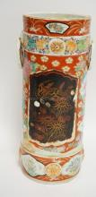 ASIAN PORCELAIN CYLINDER VASE MEASURING 12 3/4 INCHES HIGH. HAS SOME CHIPS TO THE ENAMEL.