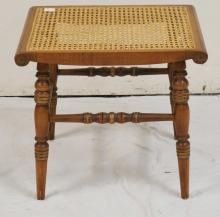 HITCHCOCK STYLE BENCH WITH A CANED TOP AND GOLD STENCILING. 18 1/4 INCHES HIGH.