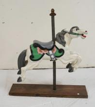 CARVED AND PAINTED WOODEN CAROUSEL HORSE. 30 INCHES LONG.