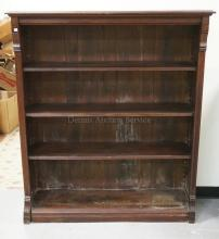 VICTORIAN WALNUT OPEN BOOKCASE. LINE CARVED. 58 INCHES HIGH. 50 1/2 INCHES WIDE.