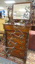 CLAW FOOT MAHOGANY 5 DRW HIGH CHEST W/CLAW FEET, CARVED HALF COLUMNS & BEVELLED MIRROR W/FACES CARVED IN THE SUPPORT ARMS
