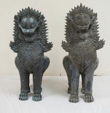 PAIR OF LARGE BRONZE ASIAN LION SCULPTURES MEASURING 37 INCHES HIGH.