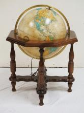 REPLOGLE *HEIRLOOM GLOBE* WITH STAND. INTERNALLY LIGHTED. 25 INCHES WIDE. 35 1/2 INCHES HIGH.