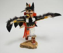 NATIVE AMERICAN INDIAN KACHINA DOLL TITLED *RED TAIL HAWK. ARTIST SIGNED. 10 3/4 INCHES HIGH.