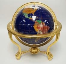 EARTH GLOBE INLAID WITH VARIOUS STONES AND A BRASS STAND. 19 1/4 INCHES HIGH. 17 1/2 INCHES WIDE.