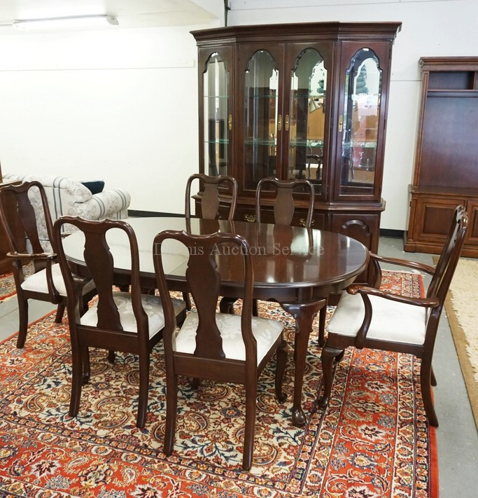 Lot Ethan Allen 8 Piece Cherry Dining Room Set 2 Piece China Cabinet With A Mirrored Back Glass Shelves And A Lighted Interior Table Measuring 44 X 66 1 2 Inches Plus Two 18 Inch Leaves And 6 Chairs
