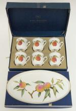 ROYAL WORCESTER COVERED CUPS WITH TRAY IN THE *EVESHAM* PATTERN. TRAY IS 11 5/8 X 6 1/2 IN, CUPS ARE 3 1/4 IN. WITH ORIGINAL BOXES.