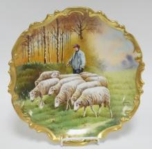 BLAKEMAN AND HENDERSON LIMOGES WALL PLATE W/ A SHEPARD AND FLOCK OF SHEEP IN A MEADOW. ARTIST SIGNED BAUMY. 12 1/4 IN