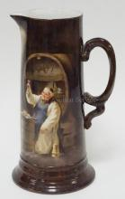JEAN POUYAT LIMOGES TANKARD PITCHER HAND PAINTED W/ A MONK RAISING A TOAST. ARTIST SIGNED E. BAKER '04. 11 5/8 IN H