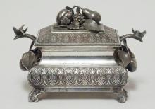 MIDDLETOWN VICTORIAN SILVER PLATED JEWELRY BOX W/ FRUIT FINIAL AND BIRD AND CHERRY HANDLES.  ENGRAVED NAME- MAUDE J KEENY. 7 1/4 IN X 4 1/4 IN, 4 3/4 IN H. SATIN LINED.