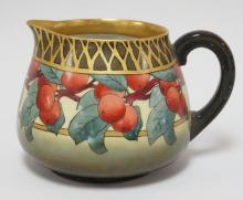 T&V LIMOGES HAND PAINTED CIDER PITCHER W/ FRUIT AND GOLD LATTICE RIM. 6 IN H