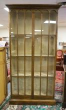 BAKER FURNITURE BOOKCASE WITH GLASS DOORS. 84 IN TALL. 43 IN WIDE.