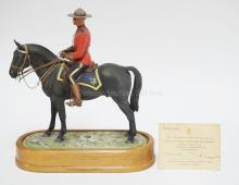 DORIS LINDNER FOR ROYAL WORCESTER *ROYAL CANADIAN MOUNTED POLICEMAN*. LIM ED 304/500 WITH CERTIFICATE. 12  IN TALL. EXTREMELY TINY GLAZE FLAKE ON BOTTOM BACK EDGE.