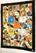 COLORFUL EMBROIDERED AND HAND PAINTED CRAZY QUILT. 65 IN X 49 IN A COUPLE OF PATCHES ARE FRAYED