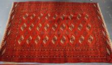 BRIGHT RED BOKARA RUG. 6 FT 7 IN X 4 FT 9 IN