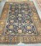 16 FT 8 IN X 12 FT BLUE ORIENTAL RUG; HAS WEAR & TORN SPOT ON ONE EDGE