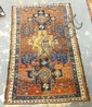 6 FT 10 IN X 4 FT 4 IN ORIENTAL RUG; RUST & NAVY BLUE