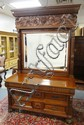 MASSIVE HIGH BACK CARVED WALNUT VICTORIAN DRESSER W/BEVELLED MIRROR; HAS LION HEADS ON SERPENT BODIES & BALL & CLAW FEET; 91 IN H, 60 IN W