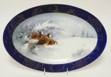 HAVILAND LIMOGES OVAL PLATTER WITH HAND PAINTED SNOW SCENE WITH QUAIL. 16 1/4 X 11 1/4 IN. SIGNED S.B. MANN. 1908