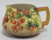 CERAMIC ARTS BELLEEK PITCHER W/ HAND PAINTED CHERRIES. ARTIST SIGNED A. PLUMB, 1901. 6 IN H