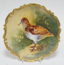 HAND PAINTED PORCELAIN CHARGER WITH A STANDING QUAIL. ARTIST SIGNED BAUMY. UNMARKED PORCELAIN. 12 3/8 IN.