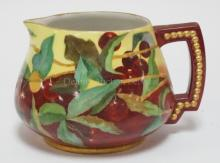 FRENCH LIMOGES CIDER PITCHER HAND PAINTED WITH CHERRIES. 5 3/8 IN TALL. MARKED J.P.L. FRANCE. ARTIST INITIALED.