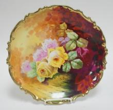AUSTRIAN PORCELAIN CHARGER WITH POLYCROME AND HAND PAINTED ACCENT DECORATION OF ROSES. 13 1/8 IN.