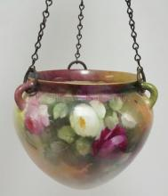 HAND PAINTED PORCELAIN HANGING BASKET DECORATED WITH RED, WHITE, AND PINK ROSES. 6 1/4 IN HIGH.