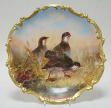 LIMOGES PORCELAIN CHARGER HAND PAINTED WITH 3 GAME BIRDS IN A FIELD. 15 3/4 IN DIAMETER. ARTIST SIGNED DUBOIS.