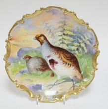 LIMOGES PORCELAIN CHARGER HAND PAINTED WITH 2 GAME BIRDS. SIGNED DUVAL. 13 1/4 IN.