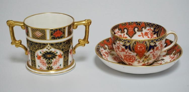 2 PIECES ROYAL CROWN DERBY. A CUP AND SAUCER AND A 2 HANDLED CUP MEASURING 2 7/8 INCHES HIGH.
