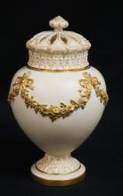 19TH C. ROYAL WORCESTER JAR WITH LID. DECORATED IN FLORAL SWAG AND RIBBON WITH A RETICULATED LID. 8 INCHES HIGH. MISSING INTERIOR LID.