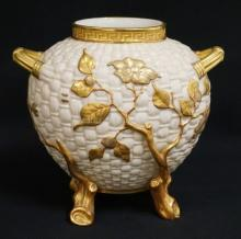 19TH CENTURY ROYAL WORCESTER PORCELAIN VASE. THE BODY IN THE MANNER OF WOVEN WICKER AND DECORATED IN GOLD BRANCHES AND LEAVES WITH RED TRIM. 7 3/4 INCHES HIGH.