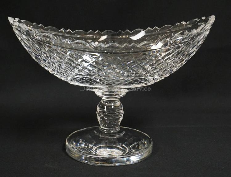 EXCEPTIONAL WATERFORD CUT GLASS CENTER BOWL. BOAT SHAPED WITH A SCALLOP CUT RIM AND DIAMOND PATTERNED SIDES. THICK AND HEAVY CRYSTAL. SIGNED ON THE SIDE OF THE BASE. EXCELLENT CONDITION. 13 1/8 X 5 3/4 INCH OVAL. 9 1/8 INCHES HIGH.