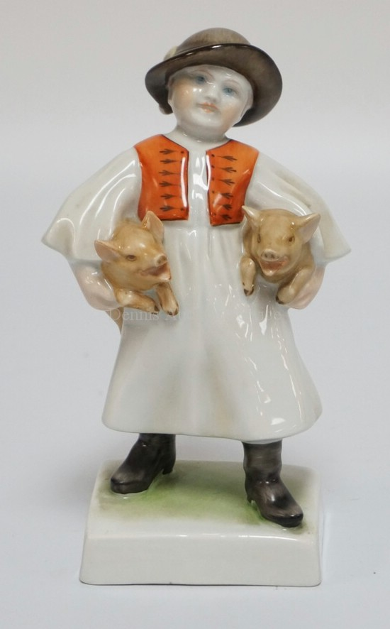 HEREND PORCELAIN FIGURE OF A PEASANT BOY WITH PIGS. BACK OF BASE READS *VASTAGH GYNE*. 7 1/4 INCHES HIGH.