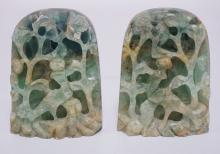 PAIR OF ASIAN CARVED GREEN STONE BOOKENDS MEASURING 5 3/4 INCHES HIGH AND 4 3/8 INCHES WIDE.