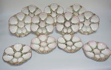 LOT OF 11 *CT* GERMANY PORCELAIN OYSTER PLATES. 9 3/8 INCH DIA. 3 WITH SMALL NICKS TO THE BASES. ONE WITH A FACTORY LINE THE RIM.