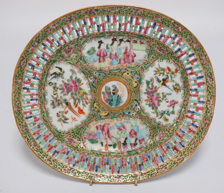 ROSE MEDALLION OVAL PLATE WITH A RETICULATED BORDER. ALTERNATING PANELS OF PEOPLE AND BIRDS WITH BUTTERFLIES AND FLOWERS. 9 1/4 X 8 5/8 INCHES.