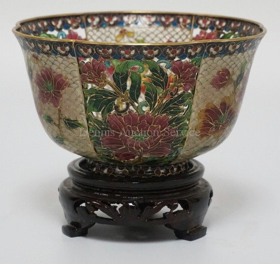 ASIAN PLIQUE-A-JOUR BRASS FRAMED OPENWORK ENAMEL DECORATED BOWL WITH WOODEN STAND. DECORATED WITH ALTERNATING PANELS OF FLOWERS. 5 INCHES WIDE. 4 INCHES HIGH.