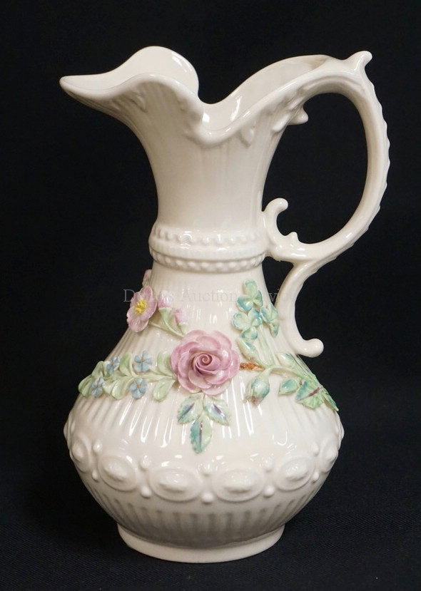 BELLEEK PORCELAIN PITCHER WITH MOULDED PATTERNS AND APPLIED COLORFUL ROSES WITH LEAVES AND OTHER FLOWERS. 9 1/4 INCHES HIGH. BROWN MARK.