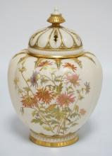 ANTIQUE ROYAL WORCESTER HAND PAINTED PORCELAIN JAR WITH LID. MELON RIBBED AND DECORATED ON BOTH SIDES WITH FLOWERS. FINIAL REPAIRED, MISSING SECONDARY INTERNAL LID, TINY FLEA BITE NEAR THE BASE AS PHOTOGRAPHED. 10 1/2 INCHES HIGH.