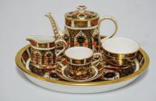 ROYAL CROWN DERBY CHILD'S TEA SET. 6 PIECE. INCLUDES THE TEAPOT, CREAM, SUGAR, CUPS, SAUCER, AND TRAY. 7 5/8 X 6 1/8 INCH TRAY. SUPERB CONDITION!