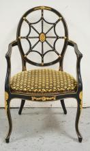 BLACK LACQUERED WHEEL BACK ARM CHAIR WITH GOLD GILT ACCENTS AND A CANED SEAT. 39 1/2 X 23 1/2 INCHES.