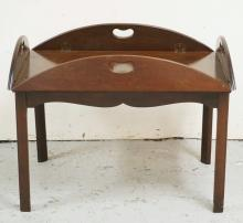 BAKER FURNITURE BUTLERS TABLE WITH A LIFT OFF TRAY TOP. 38 1/2 X 28 1/2 INCHES OVAL. 18 3/4 INCHES HIGH.